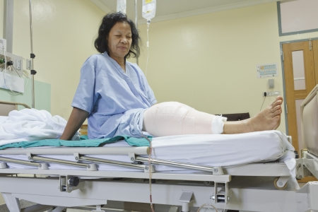 Knee replacement surgery after operation patient senior woman (60s) on the bed in hospital Stock Photo - 16567489