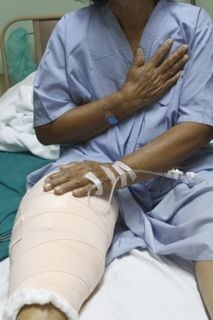 Knee replacement surgery after operation patient senior woman (60s) on the bed in hospital Stock Photo - 16567490