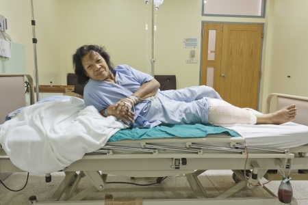 Knee replacement surgery after operation patient senior woman (60s) on the bed in hospital Stock Photo - 16567484