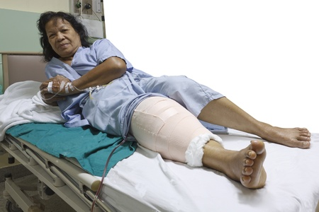 Knee replacement surgery after operation patient senior woman (60s) on the bed in hospital Stock Photo - 16567475