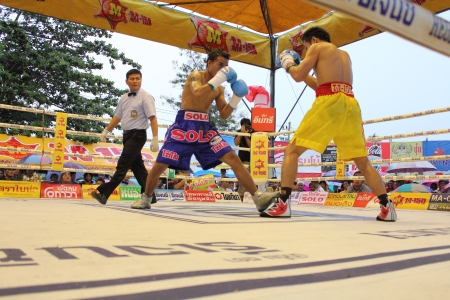 SURAT THANI, THAILAND – DECEMBER 14 : Norasing Kokietgym and Michael Escobia fight for PABA Super Flyweight Champion on December 14, 2012 in Surat Thani, Thailand.