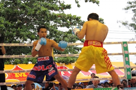 paba: SURAT THANI, THAILAND – DECEMBER 14 : Norasing Kokietgym and Michael Escobia fight for PABA Super Flyweight Champion on December 14, 2012 in Surat Thani, Thailand.