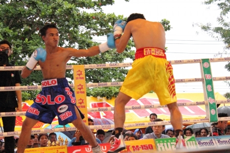 SURAT THANI, THAILAND � DECEMBER 14 : Norasing Kokietgym and Michael Escobia fight for PABA Super Flyweight Champion on December 14, 2012 in Surat Thani, Thailand.