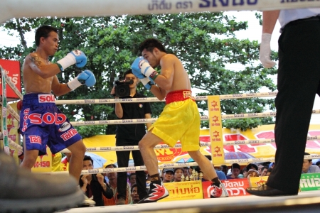wba: SURAT THANI, THAILAND - DECEMBER 14 : Norasing Kokietgym and Michael Escobia fight for PABA Super Flyweight Champion on December 14, 2012 in Surat Thani, Thailand.
