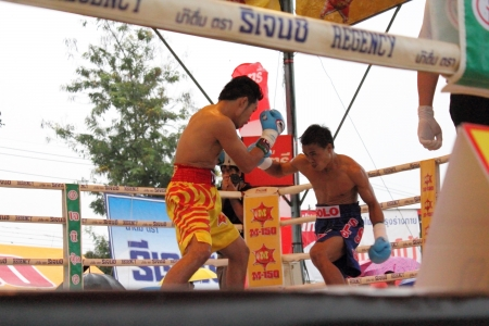 paba: SURAT THANI, THAILAND - DECEMBER 14 : Norasing Kokietgym and Michael Escobia fight for PABA Super Flyweight Champion on December 14, 2012 in Surat Thani, Thailand.
