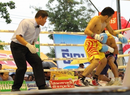 SURAT THANI, THAILAND - DECEMBER 14 : Norasing Kokietgym and Michael Escobia fight for PABA Super Flyweight Champion on December 14, 2012 in Surat Thani, Thailand.