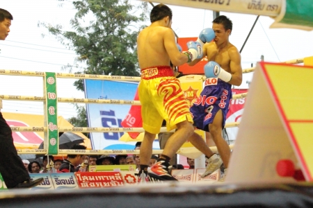 ringside: SURAT THANI, THAILAND - DECEMBER 14 : Norasing Kokietgym and Michael Escobia fight for PABA Super Flyweight Champion on December 14, 2012 in Surat Thani, Thailand.