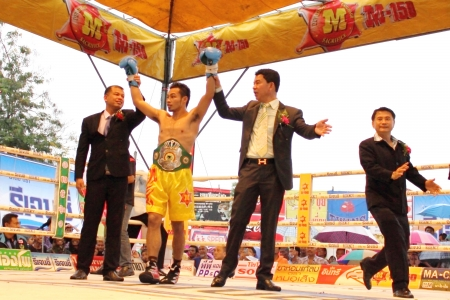 SURAT THANI, THAILAND - DECEMBER 14 : Norasing Kokietgym wins over Michael Escobia after fight for PABA Super Flyweight Champion on December 14, 2012 in Surat Thani, Thailand.