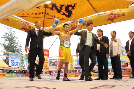 paba: SURAT THANI, THAILAND - DECEMBER 14 : Norasing Kokietgym wins over Michael Escobia after fight for PABA Super Flyweight Champion on December 14, 2012 in Surat Thani, Thailand.