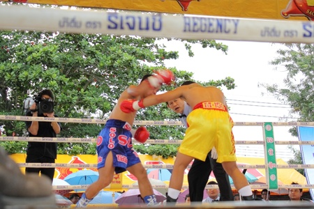 ringside: SURAT THANI, THAILAND � DECEMBER 14 : Ratchasak Sitmoaseng and Shucheelhong fight boxing on December 14, 2012 in Surat Thani, Thailand.
