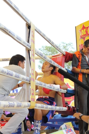 SURAT THANI, THAILAND � DECEMBER 14 : Shucheelhong break during fight boxing with Ratchasak Sitmoaseng on December 14, 2012 in Surat Thani, Thailand.