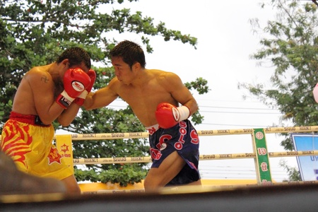 paba: SURAT THANI, THAILAND � DECEMBER 14 : Ratchasak Sitmoaseng and Shucheelhong fight boxing on December 14, 2012 in Surat Thani, Thailand.