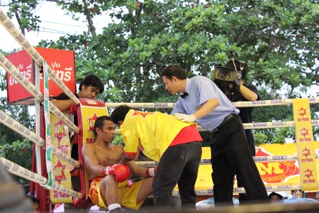 SURAT THANI, THAILAND � DECEMBER 14 : Ratchasak Sitmoaseng break during fight boxing with Shucheelhong on December 14, 2012 in Surat Thani, Thailand. Editorial