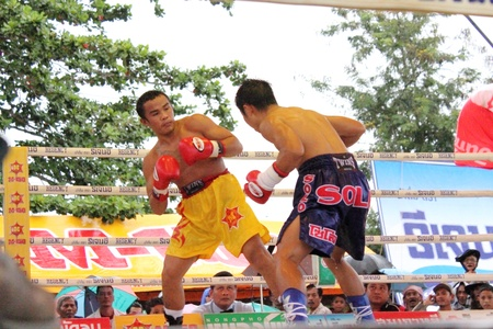 SURAT THANI, THAILAND - DECEMBER 14 : Ratchasak Sitmoaseng and Shucheelhong fight boxing on December 14, 2012 in Surat Thani, Thailand.