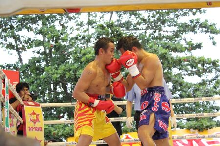 ringside: SURAT THANI, THAILAND - DECEMBER 14 : Ratchasak Sitmoaseng and Shucheelhong fight boxing on December 14, 2012 in Surat Thani, Thailand.