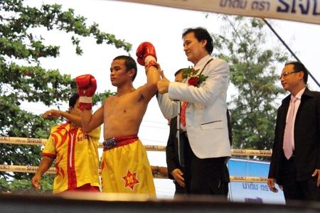 paba: SURAT THANI, THAILAND - DECEMBER 14 : Ratchasak Sitmoaseng wins over Shucheelhong after fight boxing on December 14, 2012 in Surat Thani, Thailand.