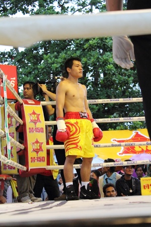 flyweight: SURAT THANI, THAILAND - DECEMBER 14 : Decha Kokietgym wait to fight boxig with Chenyujie on December 14, 2012 in Surat Thani, Thailand.
