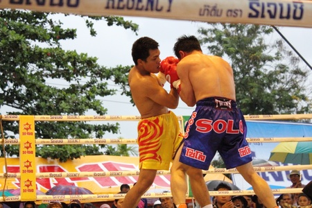 SURAT THANI, THAILAND - DECEMBER 14 : Decha Kokietgym and Chenyujie fight boxing on December 14, 2012 in Surat Thani, Thailand.