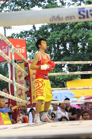 SURAT THANI, THAILAND - DECEMBER 14 : Usanakorn Kokietgym WBC Super Flyweight Champion wait to fight boxig with Leeyunting  on December 14, 2012 in Surat Thani, Thailand. Editorial