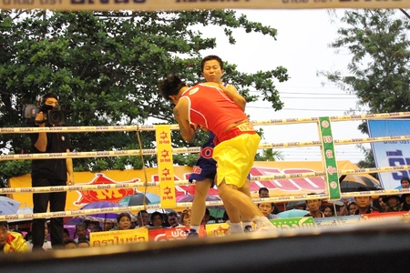 SURAT THANI, THAILAND - DECEMBER 14 : Usanakorn Kokietgym WBC Super Flyweight Champion fight boxing with Leeyunting  on December 14, 2012 in Surat Thani, Thailand.