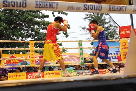flyweight: SURAT THANI, THAILAND - DECEMBER 14 : Usanakorn Kokietgym WBC Super Flyweight Champion fight boxing with Leeyunting  on December 14, 2012 in Surat Thani, Thailand.