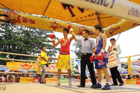 flyweight: SURAT THANI, THAILAND - DECEMBER 14 : Usanakorn Kokietgym WBC Super Flyweight Champion wins fight boxing over Leeyunting on December 14, 2012 in Surat Thani, Thailand. Editorial