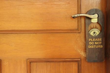 Do not disturb sign hanging on a hotel door handle Stock Photo - 18130209
