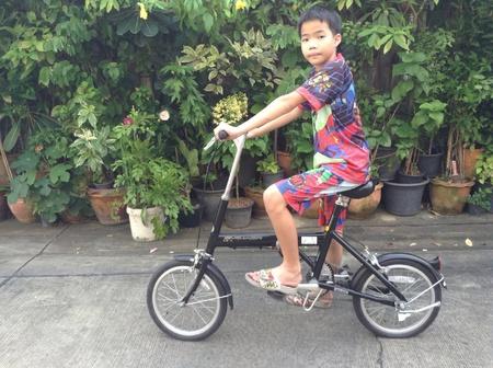 thai boy: Thai boy riding on his bicycle
