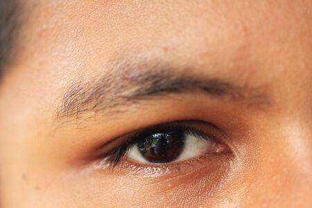 thai boy: Close up Asian Thai boy eye by use macro lens