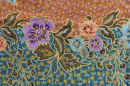 一般的な伝統的なタイスタイルのネイティブ手作りバティック布のクローズ アップの背景パターン テクスチャ織り