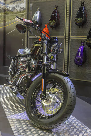sportster: BANGKOK - APRIL 2 : The Harley - Davidson Sportster XL 1200X Forth - Eight motorcycle on display at The 35th Bangkok International Motor Show on April 2, 2014 in Bangkok, Thailand.
