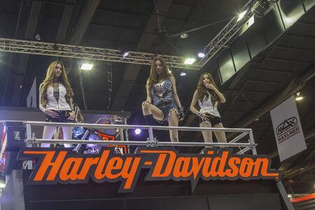BANGKOK - APRIL 2 : Unidentified model with Harley Davidson motorcycle on display at The 35th Bangkok International Motor Show on April 2, 2014 in Bangkok, Thailand.
