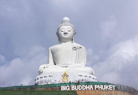 PHUKET, THAILAND - JUNE 7: The marble statue of Big Buddha formal name is Pra Puttamingmongkol Akenakkir on June 7, 2014 in Phuket, Thailand. The construction is made only on donations.