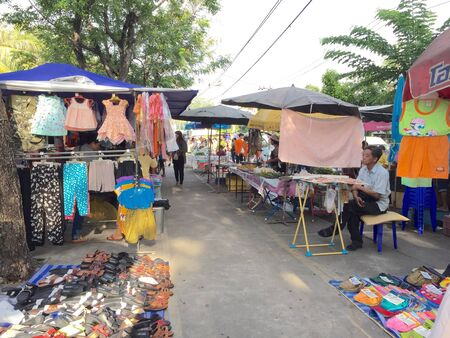 clothes: Bangkok, Thailand - May 28, 2015: Unidentifiable people shopping at market in Bangkok, Thailand. Stock Photo