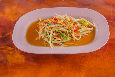 green papaya salad: Green papaya salad Thai food style on wood background Stock Photo