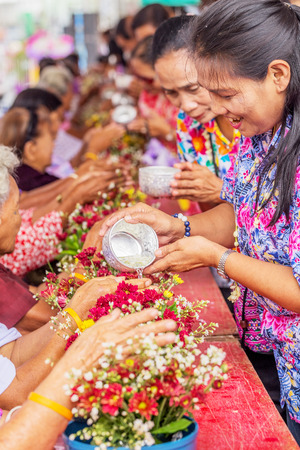 NAKHON SRI THAMMARAT, THAILAND - APRIL, 12: Unidentified Thai people celebrate Songkran by giving garlands to their seniors and asked for blessings on April 12, 2015 in Nakhon Si Thammarat, Thailand.