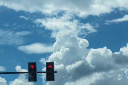 trafficlight: Traffic lights against cloudy blue sky Stock Photo
