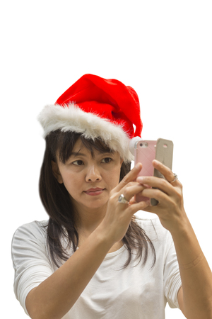 sexy pictures: Asian Thai woman in santa hat taking picture selfie by smatrphone isolated on white background