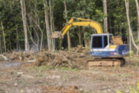 dozer: Defocused blur of crawler dozer working in the construction site for background Stock Photo