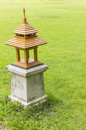 garden lamp: Green lawn with garden lamp on the grass background