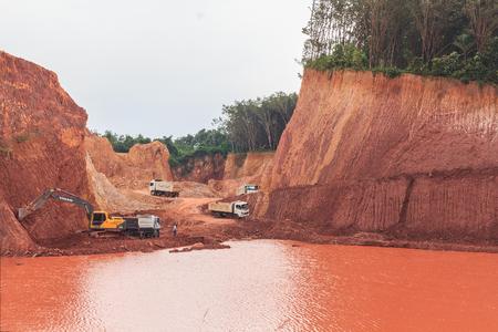 dumper: SURAT THANI, THAILAND - DECEMBER 20: Excavator digging underground and loading dumper truck December 20, 2014 in Surat Thani, Thailand.