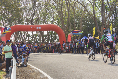 compete: SURAT THANI, THAILAND - FEBRUARY 1: Cyclists compete in the Khao Sok marathon on February 1, 2015 in Surat Thani, Thailand. Editorial