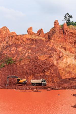 dumper truck: SURAT THANI, THAILAND - DECEMBER 20: Excavator digging underground and loading dumper truck December 20, 2014 in Surat Thani, Thailand.