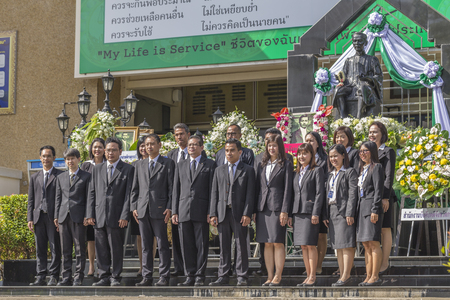 middleman: KRABI, THAILAND - AUGUST 5 : Judges and Conciliators of Chiya provincial court to take a group picture after lay wreaths to the picture of Prince Rapee Pattanasak, the Father of Thailand Law on August 5, 2016 in Krabi, Thailand. Editorial