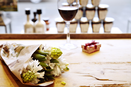 bouquet of hyacinths on wooden table in cafe in front of window. St. Valentines day