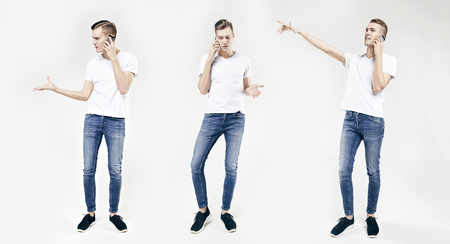 Full length portrait of handsome young business man in different poses isolated on white background, using mobile phone, wearing jeans and t-shirt Archivio Fotografico