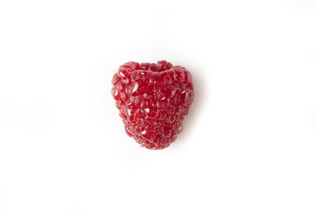 Fresh raspberry isolated on white close-up