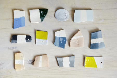 Samples of colored enamel for color ceramics, ceramic working process in studio