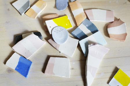Samples of colored enamel for ceramics, ceramic pieces, workshop in studio, hand-craft work