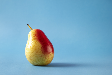 Fresh red pear on blue background, modern style fruit and vegetable food, design layout